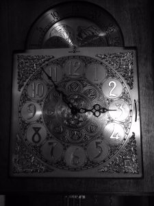 black and white photo of clock face showing time to represent it's important to take time to reflect