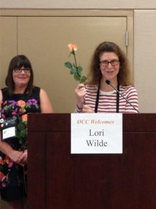 Denise M. Colby receiving her Rose for turning PRO with RWA