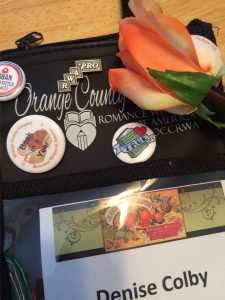 Denise M. Colby's Orange County Chapter of RWA Badge with Pins and Rose