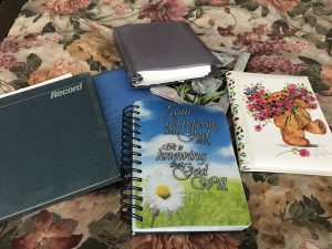 all kinds of prayer journals on bed
