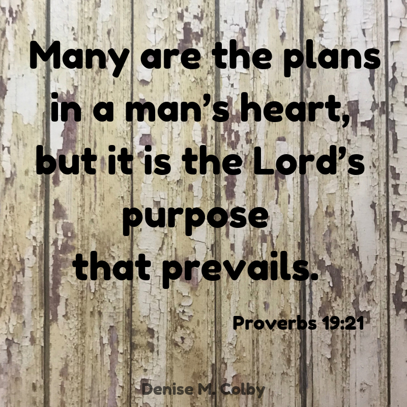 Many are the plans in a man's heart, but it is the Lord's purpose that prevails. Proverbs 19:21 text on background