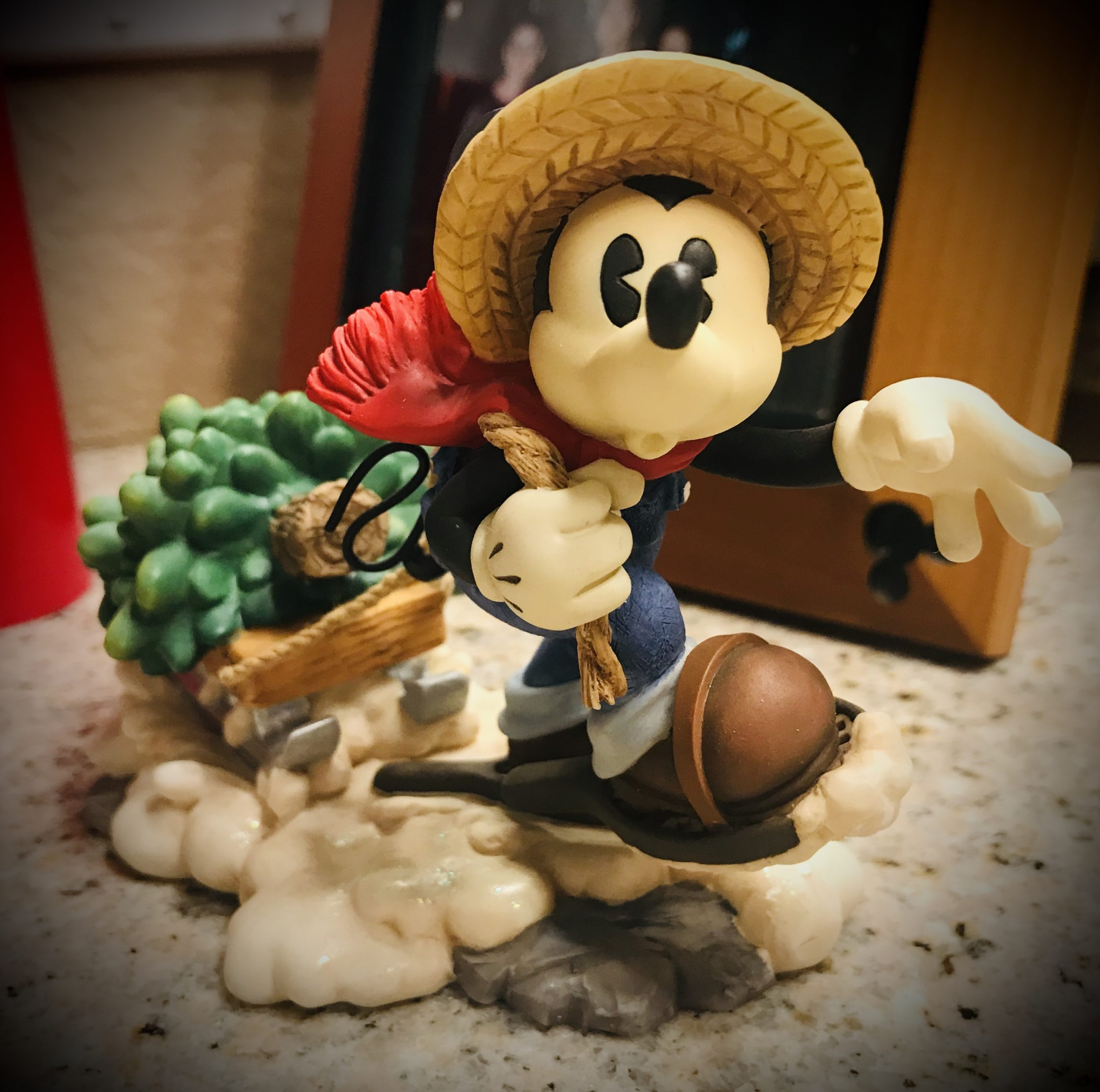 Mickey Figurine pulling a Christmas tree