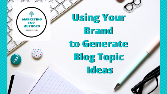 Blog Header Titled Using Brand to Generate Blog Topic Ideas by Denise M. Colby, Marketing for Authors with a photo of a desk and keyboard behind.