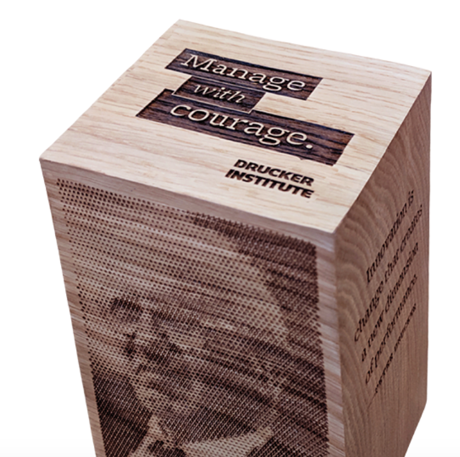 finding the word courage on a carved block of wood