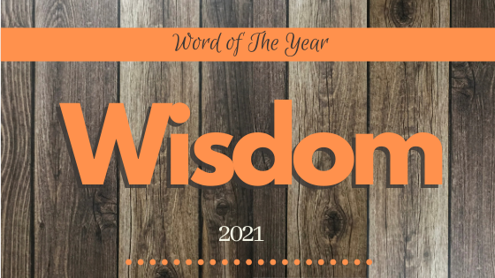 blog header title with Orange Banner with Word of the year across the top and large letters Wisdom underneath with 2021 at the bottom