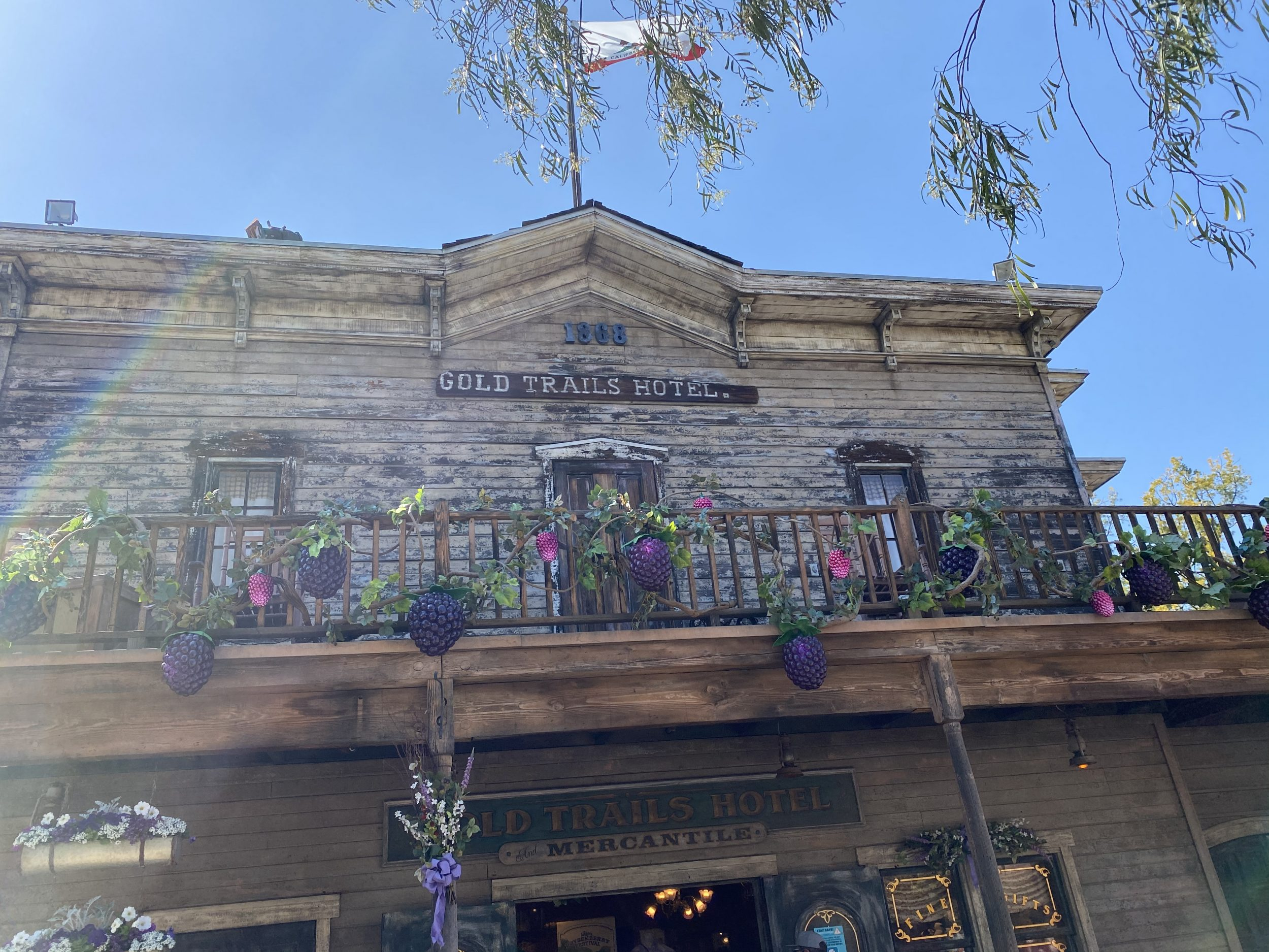 The top of the historical hotel in Ghost Town at Knott's Berry Farm has a wrap around porch and resides above the saloon