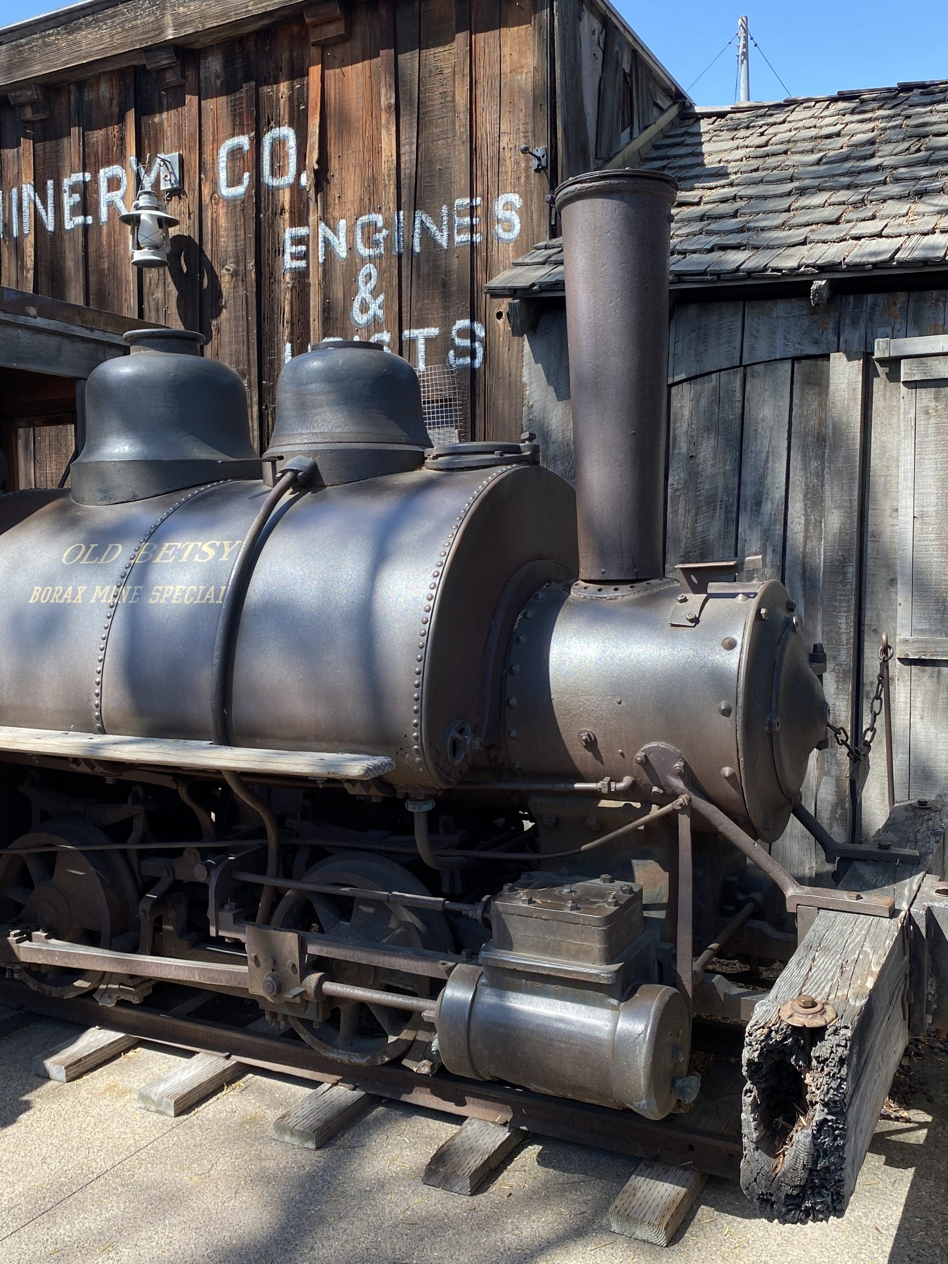 Train Engine rests amongst the historical buildings in Ghost Town at Knott's Berry Farm